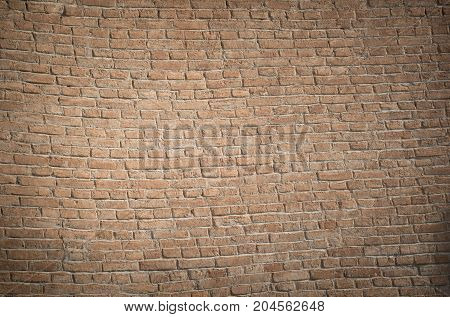 Wall of antique times from red bricks uneven