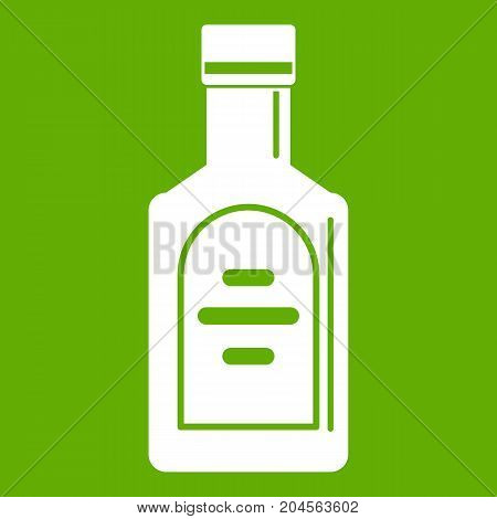 Bottle of whiskey icon white isolated on green background. Vector illustration