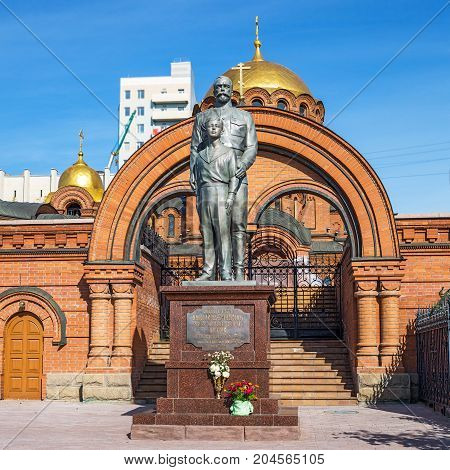 The city of Novosibirsk Siberia Russia - September 17 2017: the Monument to Emperor Nicholas II and Tsarevich Alexei at the Cathedral named after Alexander Nevsky