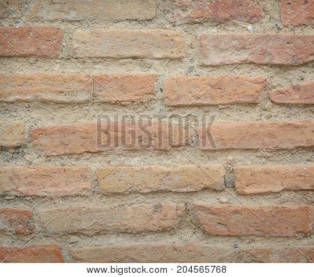 Red-orange long bricks of an ancient wall