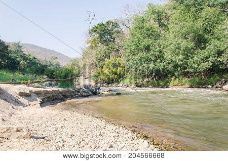 Creek and river flowing through along rocks in summer season,Ob Luang National Park,Chiangmai,Thailand