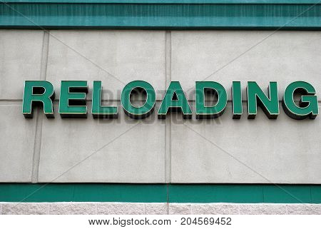 Reloading sign displayed outside for sportsmen to find guns, and ammunition