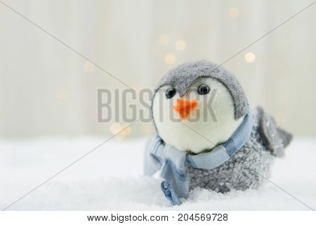 Felt Bird Ornament with Copy Space to Left Over Snow Close Up
