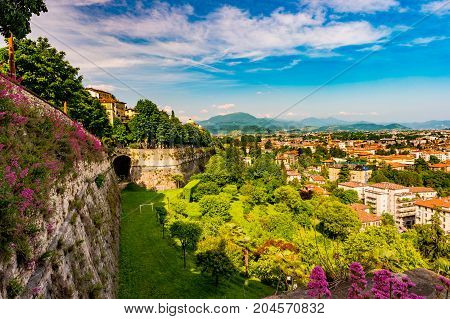 Panoramic view from Citta Alta, old town with the wall of old castle covered with flowers. Bergamo, Lombardy, Italy