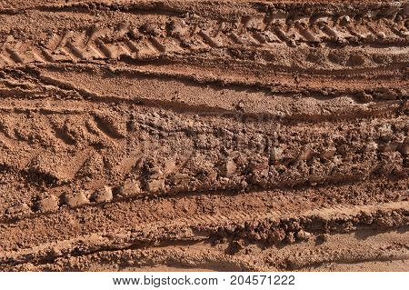 tire track of many vehicle on soil mud road in countryside in rainy season