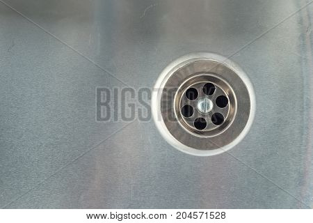 Water drain hole in stainless steel sink.