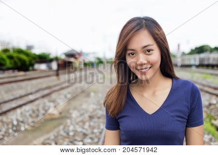 Asian Lady Action Show Windy Long Hair On Railway