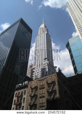 New York Usa 10 August 2017: Bottom Up View To Chrysler Building And Neighboring Buildings