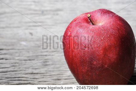 red apple on wooden background and space. fruit, natural food,