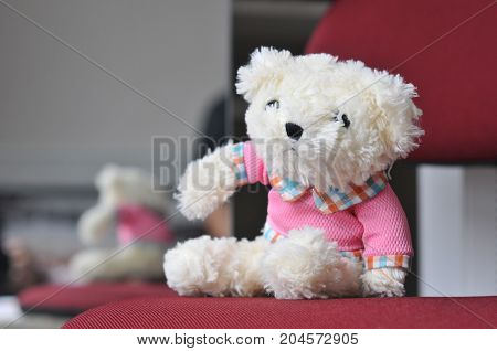 Old bear baby doll with blurry background