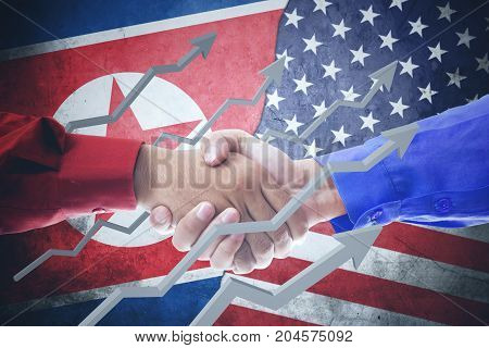 Closeup of two hands businessmen shaking hands upward arrows with North Korea and USA flag in the background