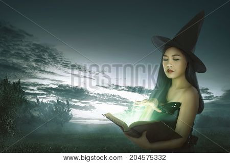 Dark Asian Witch Woman With Spell Book