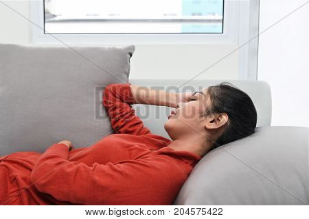Beautiful Asian Woman Sleeping On A Couch