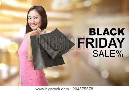 Pretty Asian Woman Holding Shopping Bags