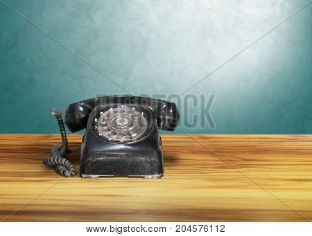 old classic vintage dial telephone on wooden table, communication