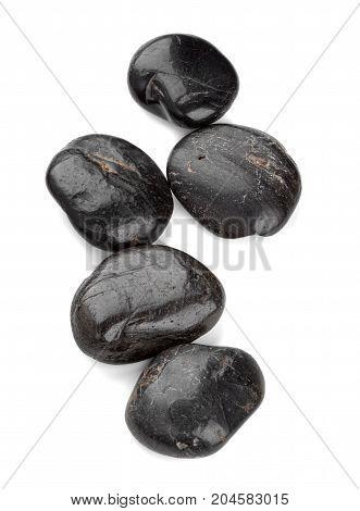 Black zen pebbles isolated on white background.