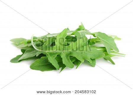 Green rucola rocket salad or arugula isolated on white background.