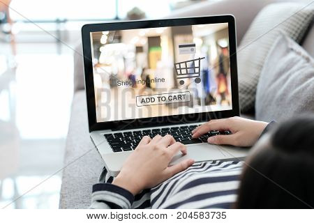 Woman hand typing laptop with shopping online device on screen background digital marketing business and technology concept lifestyle