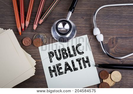 Public Health. Desk with stetascope, background for medical care.
