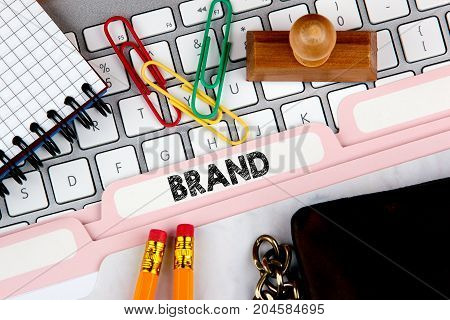 Brand, branding technology concept. Folder Register on Background of Computer Keyboard.