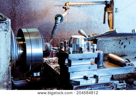 Deep drilling of parts on a lathe. Shooting in real conditions, maybe some blurring and grain.