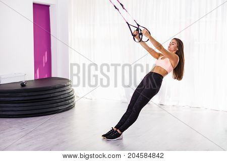 Woman Working Out With Straps