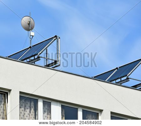 Solar panels and an antenna on the top of a building