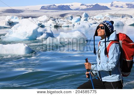 The girl admires the beauty of the glacial lagoon Jokulsarlon in southeast Iceland