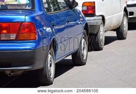 Cars in the parking lot in a row