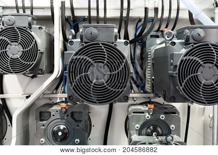 A group of powerful electric motors. Electric drive of industrial equipment. Abstract industrial background.