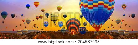 Tourists Ride Hot Air Ballons