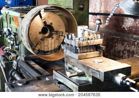 Machining of parts on a lathe. Abstract industrial background.