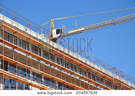 Tower crane at the construction site building a new office building