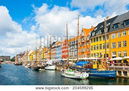 Copenhagen Denmark - August 18 2017. Famous Nyhavn pier with colorful buildings and boats in Copenhagen Denmark