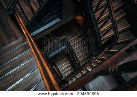 Square wooden staircase in an old building
