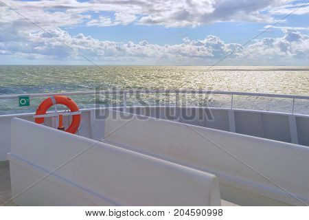A look at the Baltic Sea from the deck of a passenger ferry on a sunny day with clouds
