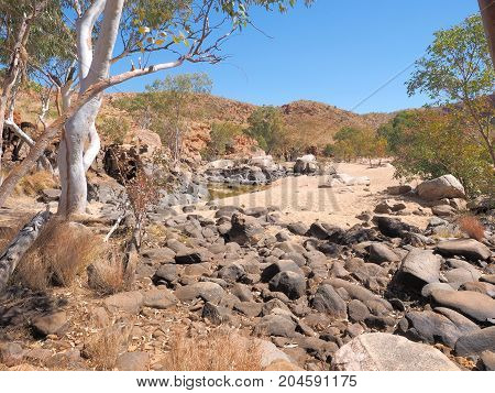 Water hole along the rim walk in the dry Ormiston Pound Northern Territory Australia 2017