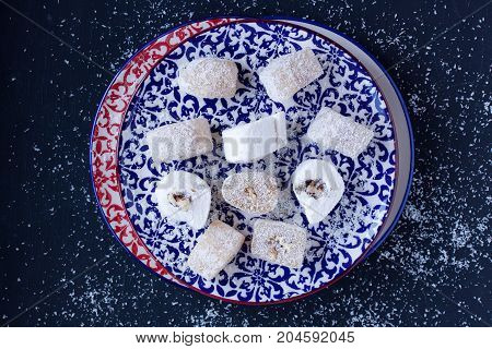 Turkish Delights in a plate on a black background