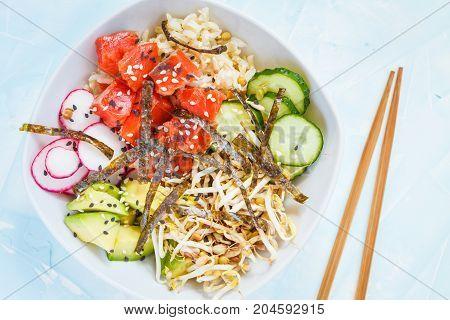 Hawaiian Ahi Poke dish with fish rice and vegetables.