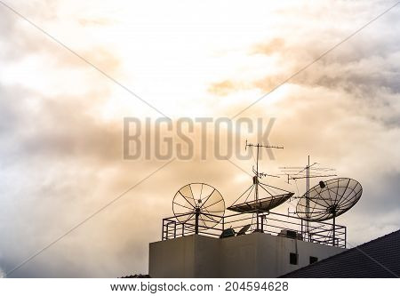 Vintage look filter with place for your text, Home satellite dish and antenna on top of building