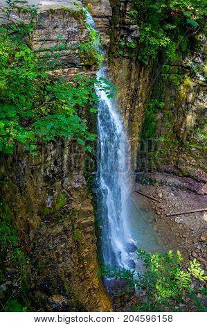 Photo of high beautiful waterfall in Carpathian mountains