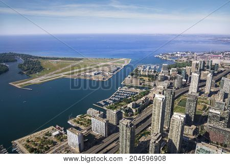 TORONTO,CANADA-AUGUST 2,2015:aerial view of the cityscape of Toronto's Harbourfront and Billy Bishop Airport during a sunny dayby the top of Cn tower.