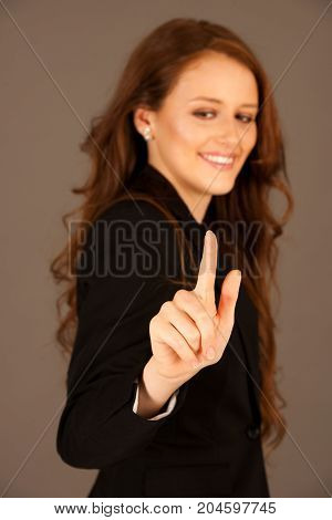 Attractive Business Woman Pressing A Virtual Button