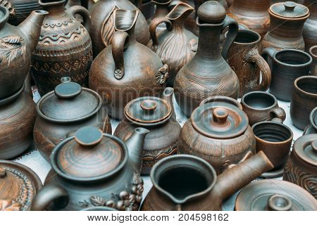 Clay handmade pottery ceramics on street market counter, toned