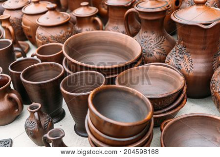 Clay handmade pottery ceramics on street market counter