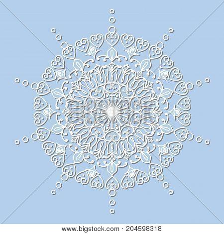 Decorative element mandala snowflake paper lace doily laser cut round ornament.