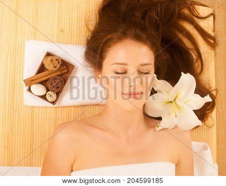 Attractive Young, Beautiful And Healthy Woman In Spa Salon. Traditional Oriental Aroma Therapy And B
