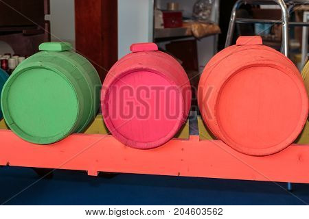 Antique Barrel Painted in Fluorescent Colors: Orange Pink and Green