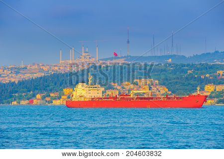 big ship passes through the Bosphorus strait on a sunset Istanbul