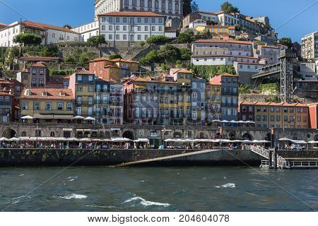 Colorful Facades Of Typical Houses On The Bank Of The River Douro - Porto, Portugal